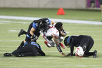 Liberty quarterback Malik Willis (7) loses his helmet while being tackled by Coastal Carolina linebacker Silas Kelly (29) and others during the first half of the Cure Bowl NCAA college football game Saturday, Dec. 26, 2020, in Orlando, Fla. Kelly was penalized on the play. (AP Photo/Matt Stamey)