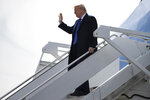 President Donald Trump arrives at Dobbins Air Reserve Base to attend a fundraiser and speak at the launch of