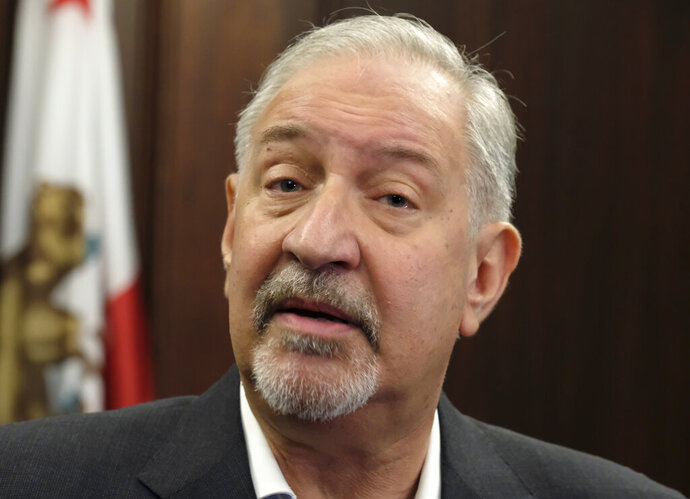 File - This Friday, Sept. 2, 2016 file photo shows attorney Mark Geragos talking to the media during a news conference in downtown Los Angeles. CNN has cut ties with Mark Geragos just hours after the celebrity attorney was named as a co-conspirator in a case accusing lawyer Michael Avenatti of trying to extort Nike. A CNN representative confirmed Monday, March 25, 2019, that Geragos is no longer a contributor to the network but didn't specify why. His name is no longer listed on CNN's website as a legal analyst. (AP Photo/Richard Vogel, file)
