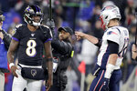 Baltimore Ravens quarterback Lamar Jackson (8) talks with New England Patriots quarterback Tom Brady prior to an NFL football game, Sunday, Nov. 3, 2019, in Baltimore. (AP Photo/Julio Cortez)