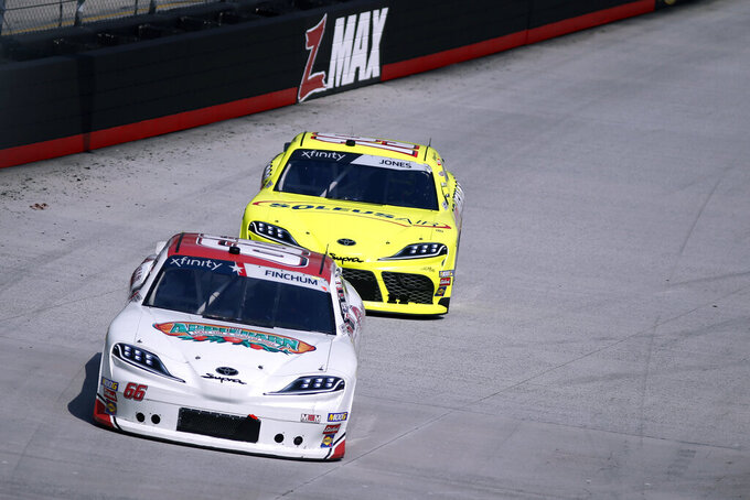 Driver Chad Finchum (66) leads Brandon Jones during practice for an NASCAR Xfinity Series auto race on Thursday, Aug. 15, 2019, in Bristol, Tenn. (AP Photo/Wade Payne)