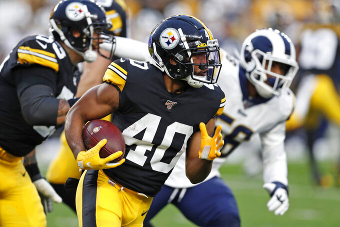 Pittsburgh Steelers running back Tony Brooks-James (40) carries the ball during the first half of an NFL football game against the Los Angeles Rams in Pittsburgh, Sunday, Nov. 10, 2019. (AP Photo/Keith Srakocic)