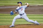 Los Angeles Dodgers starting pitcher Julio Urias throws to an Arizona Diamondbacks batter during the first inning of a baseball game Saturday, Aug. 1, 2020, in Phoenix. (AP Photo/Ross D. Franklin)