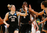 New York Liberty's Sami Whitcomb (32) reacts after making a 3-point shot against the Seattle Storm during the first half of a WNBA basketball game Friday, Aug. 20, 2021, in New York. (AP Photo/Noah K. Murray)