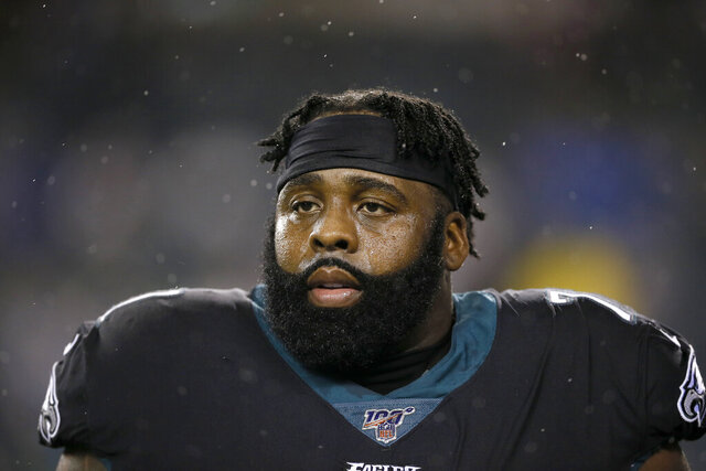 FILE - This Dec. 9, 2019, file photo shows Philadelphia Eagles' Jason Peters during an NFL football game against the New York Giants in Philadelphia. The Eagles have signed nine-time Pro Bowl left tackle Jason Peters to a one-year deal and plan to use him at right guard. The 38-year-old Peters enters his 17th season in the NFL and 12th in Philadelphia.(AP Photo/Michael Perez, File)