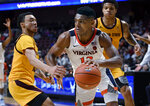 Virginia's Casey Morsell, right, dribbles around Arizona State's Jaelen House, left, during the second half of an NCAA college basketball game, Sunday, Nov. 24, 2019, in Uncasville, Conn. (AP Photo/Jessica Hill)