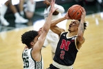 Nebraska guard Trey McGowens (2) shoots on Michigan State forward Malik Hall (25) in the first half of an NCAA college basketball game in East Lansing, Mich., Saturday, Feb. 6, 2021. (AP Photo/Paul Sancya)