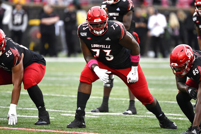 FILE - In this Oct. 26, 2019, file photo, Louisville offensive lineman Mekhi Becton (73) lines up during the first half of the team's NCAA college football game against Virginia in Louisville, Ky. New York GM Joe Douglas promised quarterback Sam Darnold's parents last summer he'd add playmakers and offensive line protectors for their son -- and he certainly gave it a shot. The Jets drafted massive Louisville offensive tackle Mekhi Becton with the No. 11 overall pick and took Baylor speedy wide receiver Denzel Mims in the second round. (AP Photo/Timothy D. Easley, File)