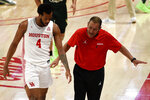 Houston head coach Kelvin Sampson, right, talks with forward Justin Gorham (4) during the first half of an NCAA college basketball game against South Florida, Sunday, Feb. 28, 2021, in Houston. (AP Photo/Eric Christian Smith)