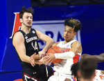Florida guard Tre Mann, right,and South Carolina forward Nathan Nelson (14) struggle for a rebound during the first half of an NCAA college basketball game Wednesday, Feb. 3, 2021, in Gainesville, Fla. (AP Photo/Matt Stamey)