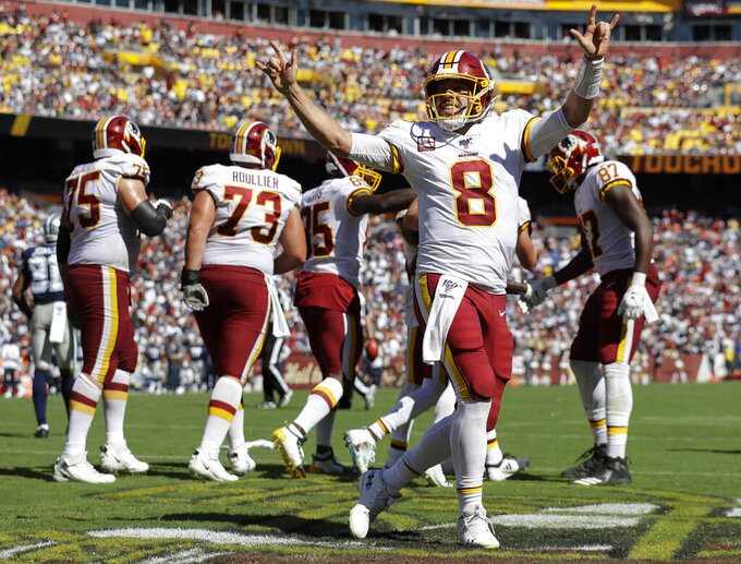 Washington Redskins quarterback Case Keenum (8) celebrates in the end zone after throwing a touchdown pass to wide receiver Paul Richardson (10) in the second half of an NFL football game against Dallas Cowboys, Sunday, Sept. 15, 2019, in Landover, Md. (AP Photo/Evan Vucci)