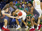 Notre Dame's Prentiss Hubb, center, loses control of the ball as Louisville's Ryan McMahon (30), Malik Williams and David Johnson, right, defend during the first half of an NCAA college basketball game Saturday, Jan. 11, 2020, in South Bend, Ind. (AP Photo/Robert Franklin)
