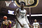 Purdue forward Trevion Williams (50) celebrates after being fouled on a basket against Minnesota during the second half of an NCAA college basketball game in West Lafayette, Ind., Thursday, Jan. 2, 2020. Purdue won 83-78 in double overtime. (AP Photo/Michael Conroy)