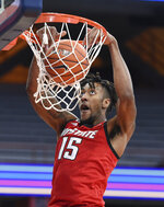 North Carolina State forward Manny Bates (15) dunks during an NCAA college basketball game Sunday, Jan. 31, 2021,  in Syracuse, N.Y. (Dennis Nett/The Post-Standard via AP)