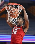 North Carolina State forward Manny Bates (15) dunks during an NCAA college basketball game Sunday, Jan. 31, 2021,  in Syracuse, N.Y. (Dennis Nett/The Post-Standard via AP)
