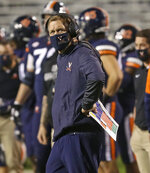 Virginia coach Bronco Mendenhall watches a replay during the team's NCAA college football game against North Carolina on Saturday, Oct. 31, 2020, in Charlottesville, Va. (Andrew Shurtleff/The Daily Progress via AP)