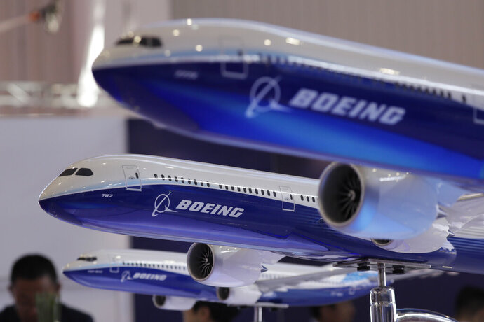 FILE- In this Nov. 6, 2018, file photo, models of Boeing passenger airliners are displayed during the Airshow China in Zhuhai city, south China's Guangdong province. China's airline industry association has thrown its support behind 13 Chinese carriers seeking compensation from Boeing for groundings of the 737 Max 8. (AP Photo/Kin Cheung, File)