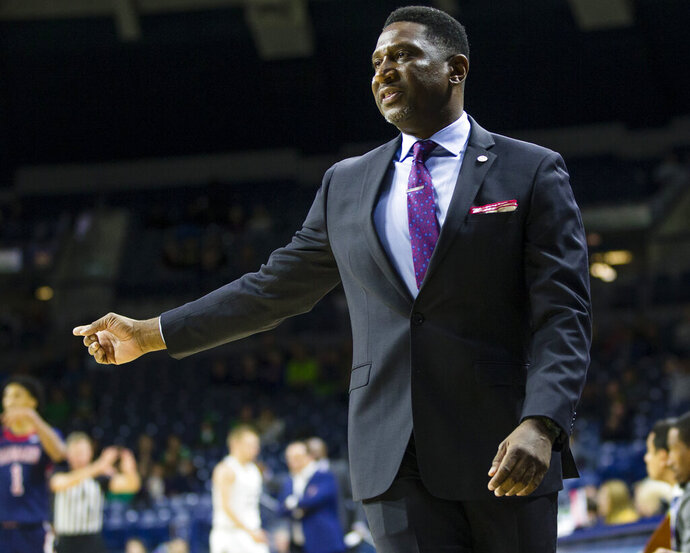 Howard head coach Kenneth Blakeney talks to the referee during an NCAA college basketball game against Notre Dame Tuesday, Nov. 12, 2019 at Purcell Pavilion in South Bend, Ind. (Michael Caterina/South Bend Tribune via AP)