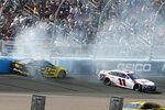 Brad Keselowski (2) and Denny Hamlin (11) crash during lap 65 of a NASCAR Cup Series auto race at Phoenix Raceway, Sunday, March 8, 2020, in Avondale, Ariz. (AP Photo/Ralph Freso)