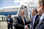 U.S. Secretary of State Mike Pompeo, center, says goodbye to U.S. Ambassador to the Philippines Sung Kim, second from right, as he boards his plane at Colonel Jesus Villamor Airbase, in Manila, Philippines, Friday, March 1, 2019, to travel to Washington. (AP Photo/Andrew Harnik, Pool)