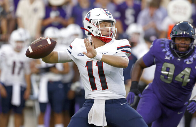 Duquesne quarterback Joe Mischler (11) looks to pass as TCU defensive tackle Corey Bethley (94) closes during the first half of an NCAA college football game Saturday, Sept. 4, 2021, in Fort Worth, Texas. (AP Photo/Ron Jenkins)