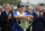 FILE - In this May 19, 2019, file photo, Brooks Koepka poses with the Wanamaker Trophy after winning the PGA Championship golf tournament at Bethpage Black in Farmingdale, N.Y. Koepka this year tries to become only the fifth player to win majors in four consecutive years. (AP Photo/Julio Cortez. File)