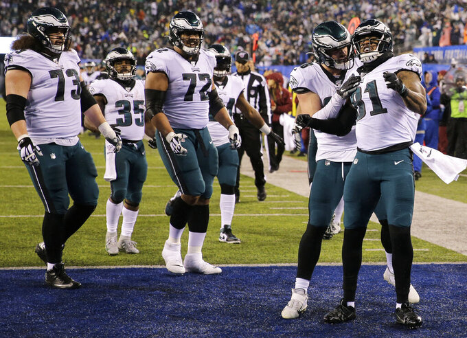 Philadelphia Eagles tight end Josh Perkins (81) celebrates a touchdown in the first half of an NFL football game against the New York Giants, Sunday, Dec. 29, 2019, in East Rutherford, N.J. (AP Photo/Seth Wenig)