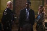 This image released by STXfilms shows, from left, J.K. Simmons, Chadwick Boseman and Sienna Miller in a scene from