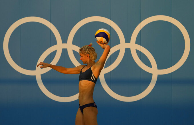 FILE - In this July 20, 2021, file photo, Germany's Laura Ludwig throws the ball during a Beach Volleyball training session ahead of the 2020 Summer Olympics, in Tokyo. The Tokyo Games have 18 new events this year and will be the first with nearly equal gender participation. (AP Photo/Mark Baker, File)
