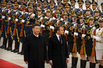 Chinese President Xi Jinping, left, and French President Emmanuel Macron review an honor guard during a welcome ceremony at the Great Hall of the People in Beijing, Wednesday, Nov. 6, 2019. (AP Photo/Mark Schiefelbein)