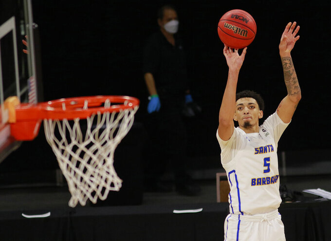UC Santa Barbara's Miles Norris (5) lines up a shot during the second half of an NCAA college basketball game for the championship of the Big West Conference men's tournament Saturday, March 13, 2021, in Las Vegas. UC Santa Barbara won 79 to 63. (AP Photo/Ronda Churchill)