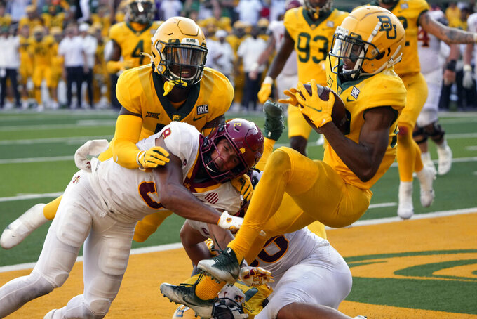 Baylor safety JT Woods (22) intercepts the ball in the end zone on a two-point conversion attempt by Iowa State during the second half of an NCAA college football game, Saturday, Sept. 25, 2021, in Waco, Texas. Baylor won 31-29. (AP Photo/Jim Cowsert)