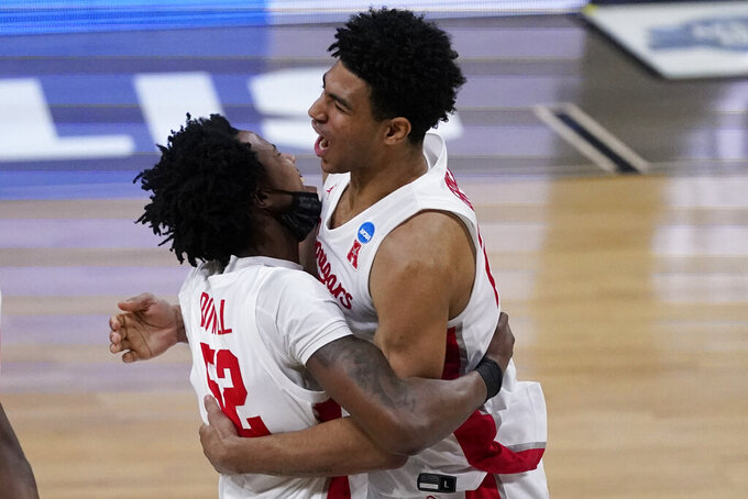 Houston center Kiyron Powell (52) celebrates with teammate Quentin Grimes, right, after an Elite 8 game against Oregon State in the NCAA men's college basketball tournament at Lucas Oil Stadium, Monday, March 29, 2021, in Indianapolis. Houston won 67-61. (AP Photo/Darron Cummings)