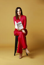 """In this photo provided by Hannah Gordon, Gordon, chief administrative officer and general counsel for the San Francisco 49ers NFL football team, poses with her book, """"SZN of Change."""" (Courtesy of Hannah Gordon via AP)"""