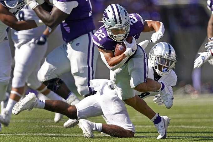 Kansas State running back Deuce Vaughn (22) gets past Nevada defensive back JoJuan Claiborne to run the ball during the second half of an NCAA college football game Saturday, Sept. 18, 2021, in Manhattan, Kan. (AP Photo/Charlie Riedel)