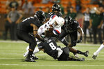 Arizona running back J.J. Taylor (21) tries to break through the Hawaii defense during an NCAA college football game, Saturday, Aug. 24, 2019, in Honolulu. (AP Photo/Marco Garcia)