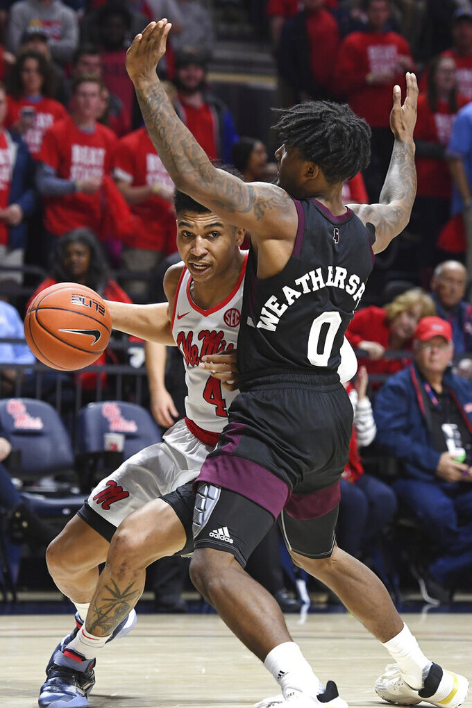 Mississippi guard Breein Tyree (4) looks for room past Mississippi State guard Nick Weatherspoon (0) during the second half of an NCAA college basketball game in Oxford, Miss., Tuesday, Feb. 11, 2020. Mississippi won 83-58. (AP Photo/Thomas Graning)