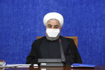 "In this Oct. 13, 2020, photo, released by the official website of the office of the Iranian Presidency, President Hassan Rouhani wearing a protective face mask to help prevent spread of the coronavirus attends a meeting in Tehran, Iran. Iran is confronting a new surge of infections that is filling hospitals and cemeteries alike. Weeks after Rouhani called in-person instruction at schools ""our first priority,"" the government shut the newly resumed schools and universities in the capital.  (Office of the Iranian Presidency via AP)"