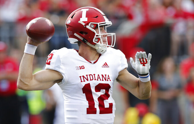 Indiana quarterback Peyton Ramsey throws a pass against Ohio State and during the first half of an NCAA college football game Saturday, Oct. 6, 2018, in Columbus, Ohio. (AP Photo/Jay LaPrete)
