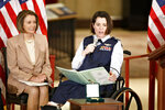 In this March 10, 2010 file photo, Air Force Lt. Col. Nicole Malachowski, right, is joined by House Speaker Nancy Pelosi at a ceremony honoring the Women Airforce Service Pilots, or WASPs, on Capitol Hill in Washington. Malachowski, is among 10 people who will be inducted into the National Women's Hall of Fame during a ceremony on Saturday, Sept. 14, 2019. (AP Photo/J. Scott Applewhite, File)
