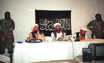 FILE - In this 1998 file photo, Ayman al-Zawahri, center left, and Osama bin Laden, center, hold a news conference in Afghanistan. Born out of the 1980s war against the Soviet Union's occupation of Afghanistan, the terror group al-Qaida under bin Laden grew into a generational threat to America that culminated in its Sept. 11, 2001, attack that brought down the World Trade Center in New York. (AP Photo/File)