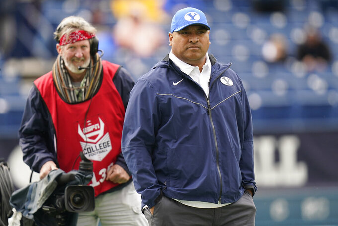 FILE - BYU head coach Kalani Sitake looks on before the start of their NCAA college football game against Boise State  in Provo, Utah, in this Saturday, Oct. 9, 2021, file photo. BYU coach Kalani Sitake said he has known Baylor coach Dave Aranda  for a long time, and that they have shared a lot of ideas and philosophies about coaching. Baylor and BYU meet in a matchup of 5-1 teams on Saturday, Oct. 16, 2021.(AP Photo/Rick Bowmer, File)