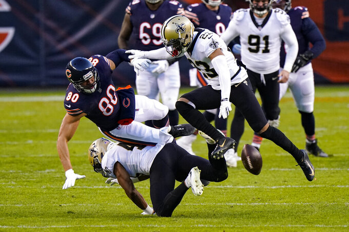 New Orleans Saints cornerback Marshon Lattimore (23) breaks up a pass intended for Chicago Bears tight end Jimmy Graham (80) in the first half of an NFL football game in Chicago, Sunday, Nov. 1, 2020. (AP Photo/Nam Y. Huh)