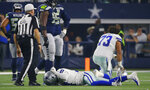 Dallas Cowboys wide receiver Allen Hurns (17) pounds his fist on the ground after breaking his ankle on a pass play in the first half of the NFC wild-card NFL football game against the Seattle Seahawks, in Arlington, Texas, Saturday, Jan. 5, 2019. (AP Photo/Ron Jenkins)