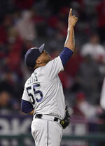 Seattle Mariners relief pitcher Roenis Elias gestures as the Mariners defeated the Los Angeles Angels 5-3 in a baseball game Friday, April 19, 2019, in Anaheim, Calif. (AP Photo/Mark J. Terrill)