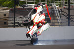 The car driven by Patricio O'Ward, of Mexico, goes airborne after hitting the wall in the second turn during practice for the Indianapolis 500 IndyCar auto race at Indianapolis Motor Speedway, Thursday, May 16, 2019 in Indianapolis. (AP Photo/Mike Fair)