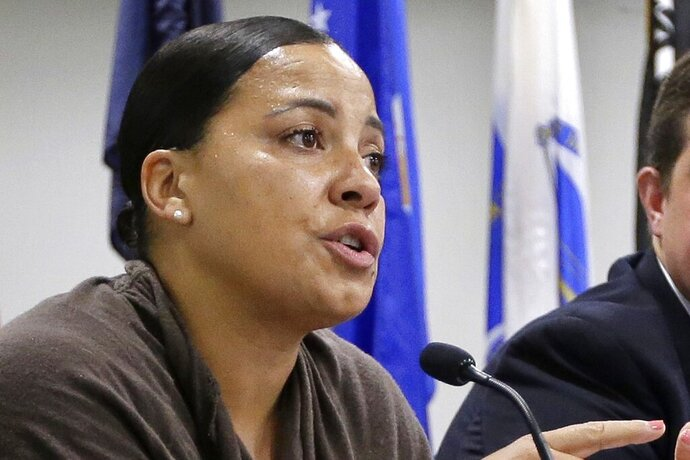 FILE - In this June 26, 2018, file photo, then-Suffolk County District Attorney Democratic candidate Rachael Rollins speaks during a forum in Boston. On Tuesday, Aug. 11, 2020, District Attorney Rollins criticized The Massachusetts Bail Fund for paying for the release of a convicted rapist, who has since been charged with a new rape. A statement from the bail fund said Wednesday that it bails out people based on financial need