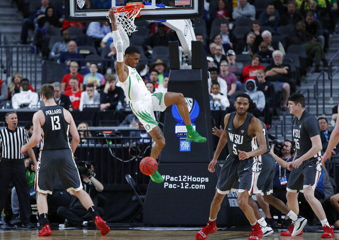 Oregon's Kenny Wooten dunks against Washington State during the first half of an NCAA college basketball game in the first round of the Pac-12 men's tournament Wednesday, March 13, 2019, in Las Vegas. (AP Photo/John Locher)