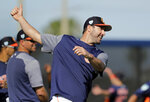 Houston Astros pitcher Justin Verlander stretches during spring training baseball practice Friday, Feb. 15, 2019, in West Palm Beach, Fla. (AP Photo/Jeff Roberson)