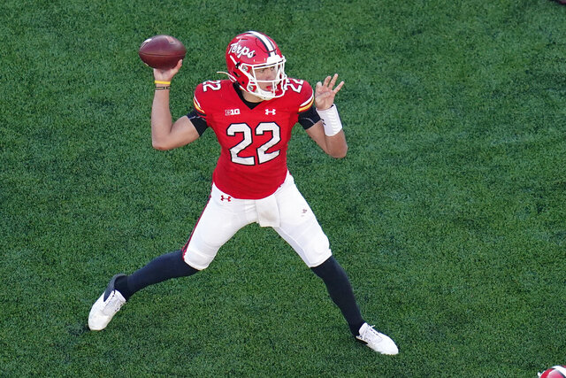 Maryland quarterback Eric Najarian throws a pass against Rutgers during the second half of an NCAA college football game, Saturday, Dec. 12, 2020, in College Park, Md. Rutgers won 27-24 in overtime. (AP Photo/Julio Cortez)